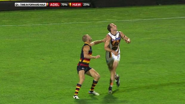 Feather touch ... Adelaide's Scott Thompson was penalised for a slight touch on Hawthorn's David Hale.