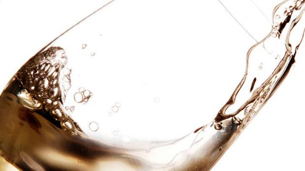 A woman drank 10 glasses of wine and six glasses of pre-mixed spirits before falling through a glass panel.