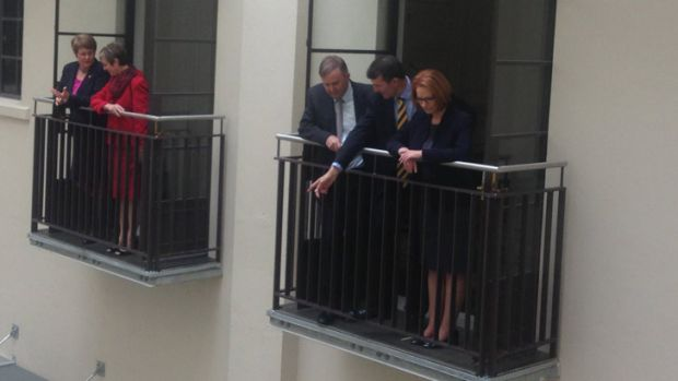Lord Mayor Graham Quirk shows off the renovated City Hall to PM Julia Gillard.