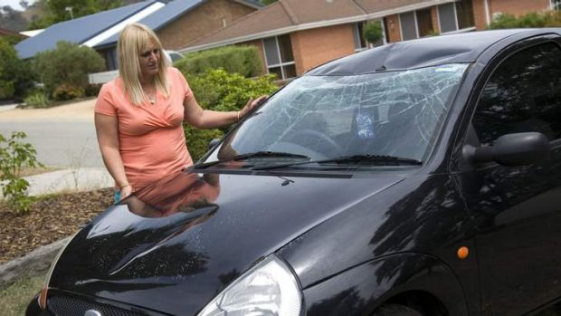 Leanne Burrows, with her first car that was damaged by vandals in January.