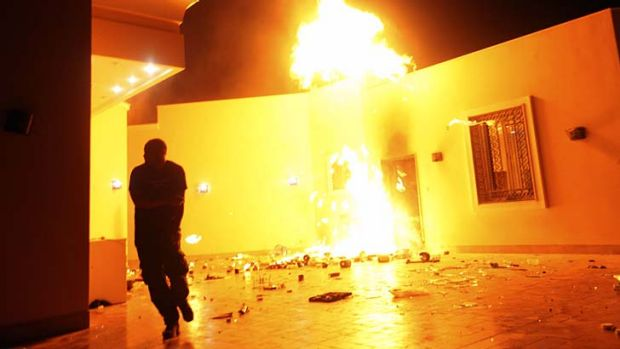 Deadly: The US consulate in Benghazi in flames during the terrorist attack last September.