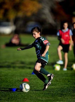 The Vision Australia soccer ball that makes a noise when kicked helps Claire Falls, 10, while playing soccer due to her ...
