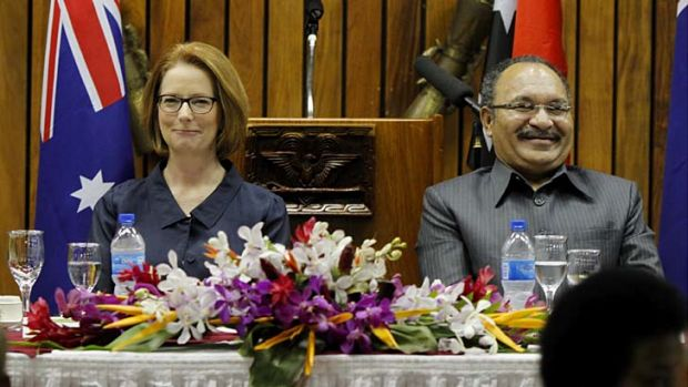 Prime Minister Julia Gillard with PNG Prime Minister Peter O'Neill at state dinner in Port Moresby.
