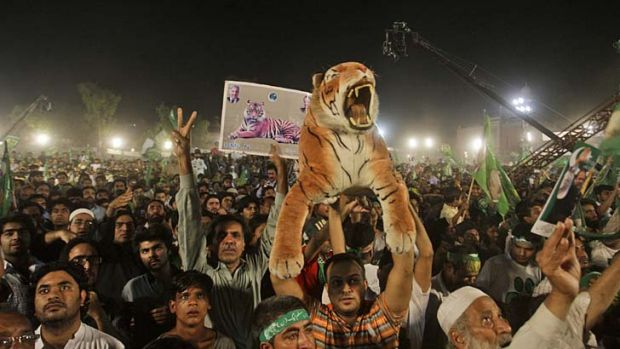 Down to the wire: Supporters listen to Pakistan Muslim League-Nawaz leader Nawaz Sharif during a rally in Lahore.