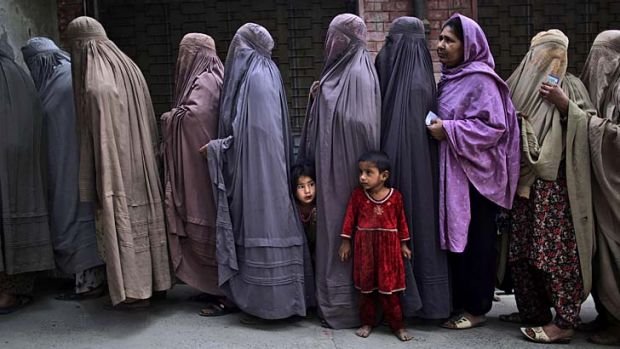 Pakistani women line up to enter a polling station on the outskirts of Islamabad, Pakistan