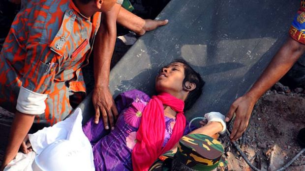 Daylight: Reshma Akhter, 18, is pulled from the collapsed Rana Plaza in Bangladesh.