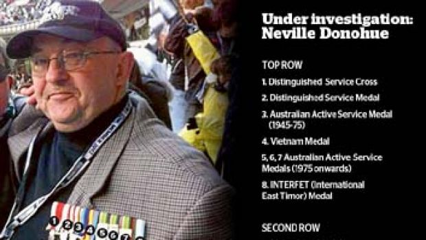 Highly decorated, highly suspect: Neville Donohue poses with an array of medals.