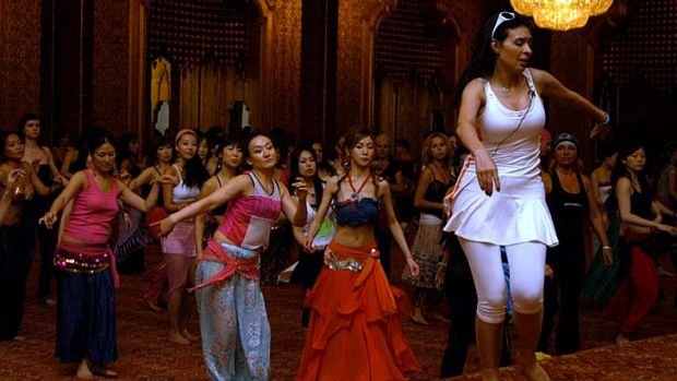 In demand: Belly dancer Dina gives a lesson in Cairo during an international contest.