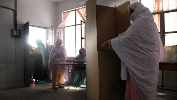 Saira casts her vote in Pakistan's general election on Saturday. More women were registered to vote than in any previous ...