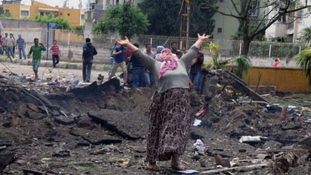 Devastation: A woman in despair at the site of one of the blasts near the Turkey-Syria border.
