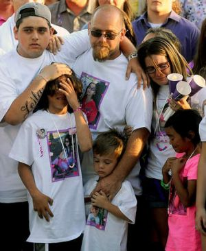 The family of slain 8-year-old girl Leila Fowler attend a vigil held for her at Jenny Lind Elementary School in Valley ...