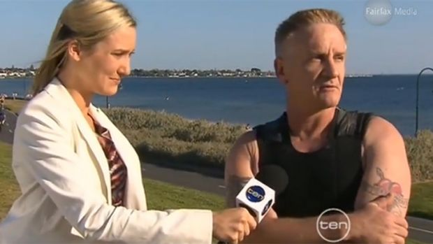 Andrew Houston is interviewed by a reporter after being attacked by a small shark at Elwood beach in October 2011.