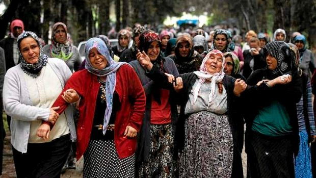 Relatives of Ahmet Uyan, 45, and Ahmet Ceyhan, 23, who were killed in Saturday's car bombings, mourn in the town of ...