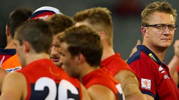 Under siege: Melbourne coach Mark Neeld lets the players do the talking during the Demons' huge loss to Gold Coast at ...