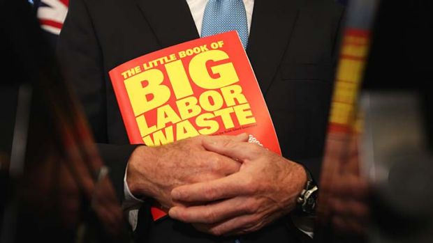 Literary creation: Tony Abbott clutches his new effort.