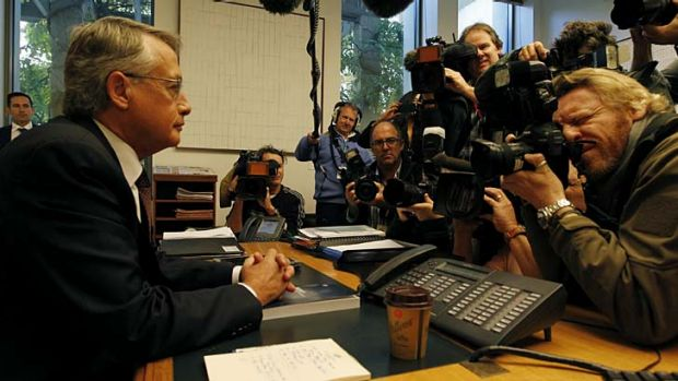 Treasurer Wayne Swan poses for the media with the 2013 budget at Parliament House.