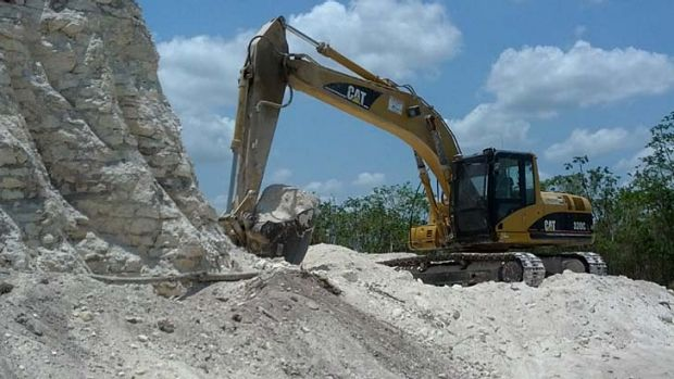 Bulldozers were used to extract crushed rock for a road-building project.