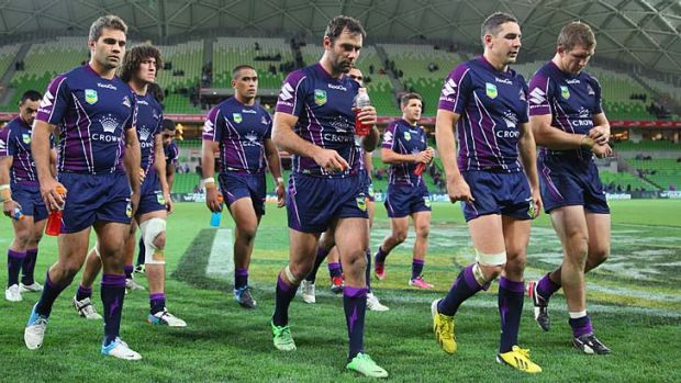 Off the boil: Cameron Smith leads his teammates off the field after their loss to the Raiders.