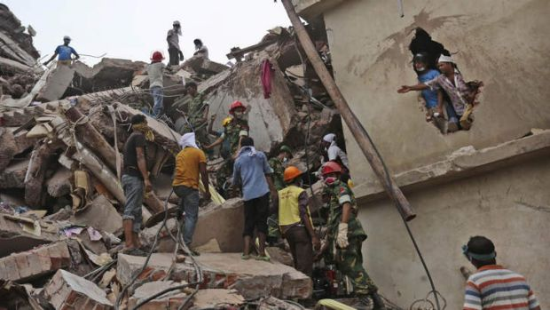 Rescue workers search for victims amid the rubble of a building that collapsed in Savar, near Dhaka, Bangladesh.