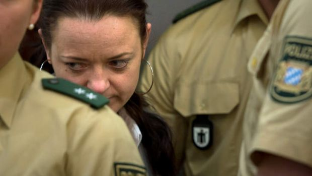Defendant Beate Zschaepe arrives in court on the second day of the NSU neo-Nazi murder trial on May 14, 2013 in Munich, ...