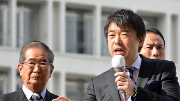 Osaka Mayor and Japan Restoration Party co-leader Toru Hashimoto delivering a speech for an election compaign while ...