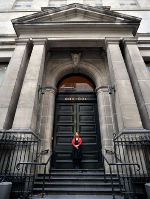 Sue Roberts pictured in front of the State Library's Russell Street frontage, which she wants to reopen.