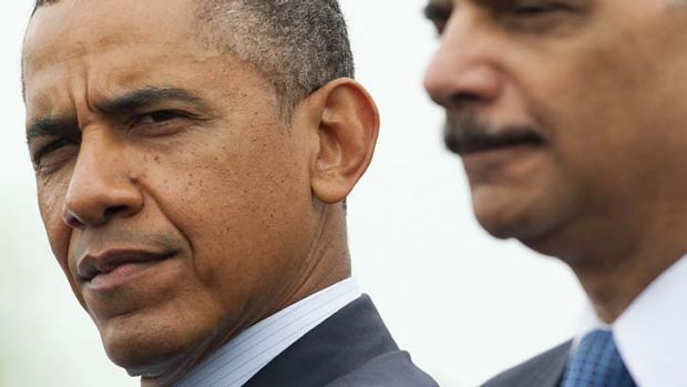 Pensive: US President Barack Obama and Attorney-General Eric Holder at the National Peace Officers' Memorial Service on ...