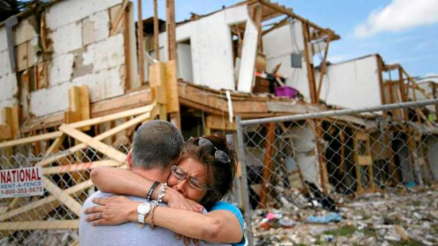 Shona Jupe, a resident of the apartment destroyed by the April 17 fertiliser plant explosion, hugs a friend while ...