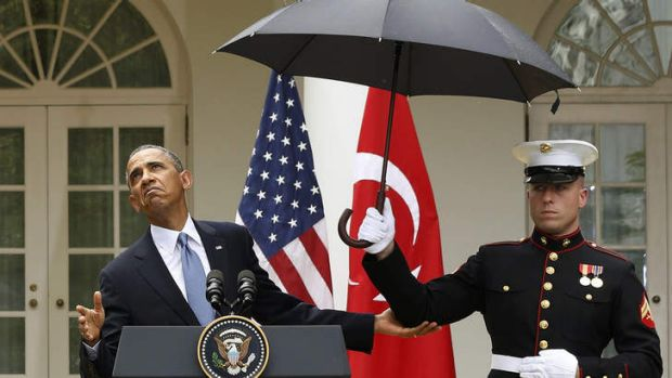 Heavy weather: Barack Obama faced questions over three bad news stories for his administration.