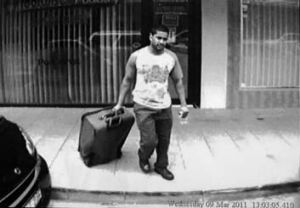 Callous lies: Footage of Daniel Stani-Reginald loading his suitcase into the taxi.