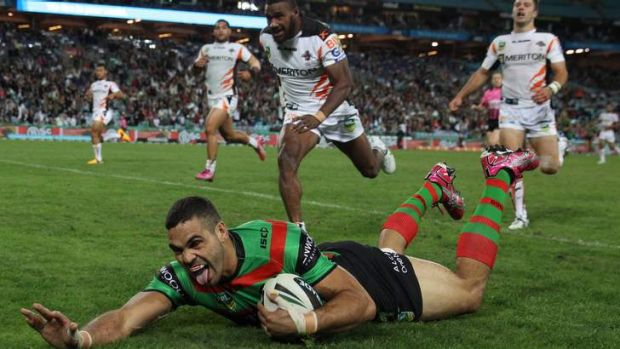 Tongue lashing: Greg Inglis scores one of his four tries against a dismal Tigers outfit.