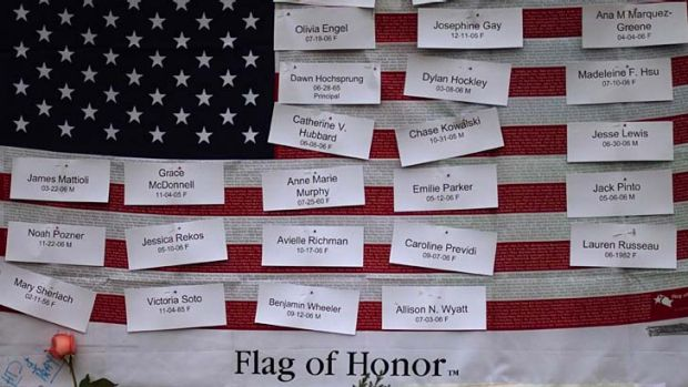 Victims of the Newtown school shooting are remembered on a U.S. flag. A further 4000 Americans have been killed by gun ...