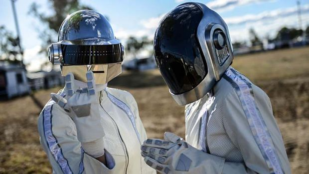 Fans wearing Daft Punk style helmets arrive at Wee Waa before the album launch.