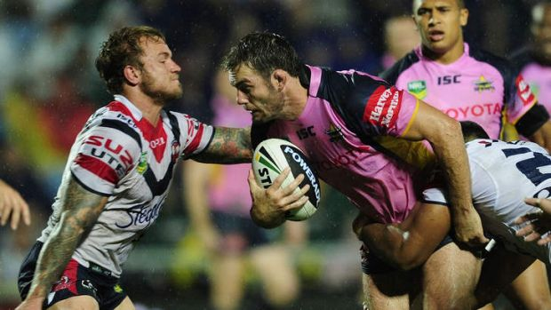 Dallas Johnson of the Cowboys is tackled by Jake Friend of the Roosters.