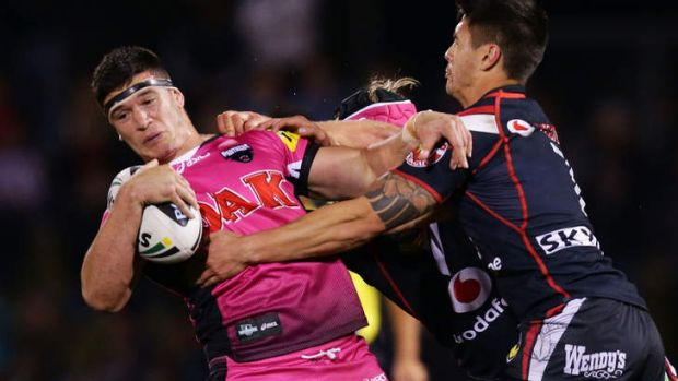 Adam Docker of the Panthers puts on a fend.