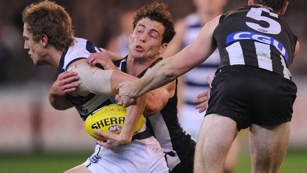 Geelong's Billie Smedts tackled by Collingwood's Jarryd Blair