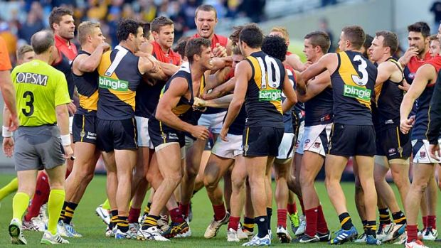 Richmond and Melbourne players get involved in a brawl at half-time.