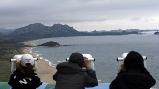 Keeping watch: South Koreans look at North Korean territory at an observation post just south of the demilitarised zone ...