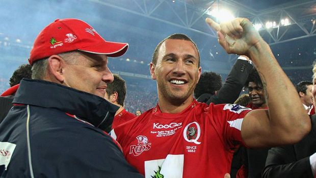 Reds boss Ewen McKenzie and his playmaker Quade Cooper.