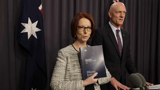Prime Minister Julia Gillard refers to the 2013 Budget papers with school education minister Peter Garrett during a ...