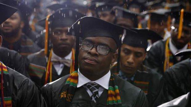 Graduates listen as Barack Obama delivers the commencement address at Morehouse College in Atlanta, Georgia.