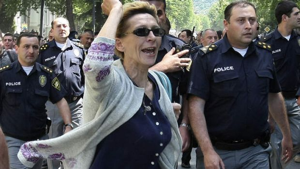 The reaction: Police mingle with protesters who opposed the the gay pride rally in Tbilisi on Friday.