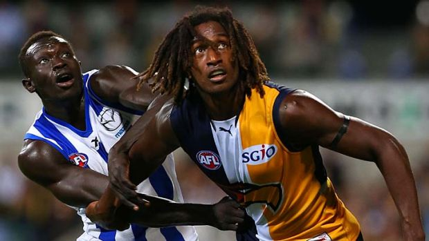 Magic man: West Coast star Nic Naitanui grapples with Sudanese sensation Majak Daw. Naitanui would be a perfect fit for ...