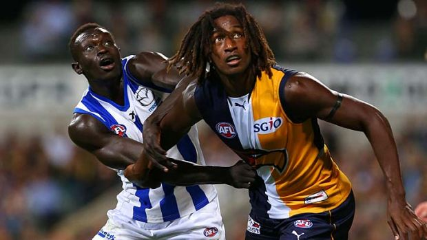 Majak Daw of the Kangaroos and Nic Naitanui of the Eagles.