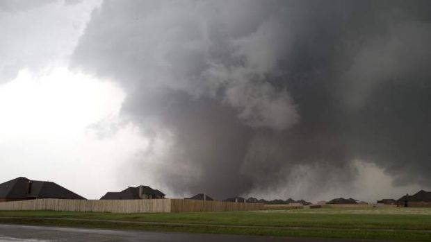 A huge tornado approaches the town of Moore, Oklahoma, near Oklahoma City, May 20, 2013.