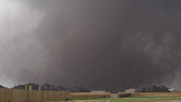 A tornado moves past homes in Moore, Oklahoma on Monday, May 20, 2013.