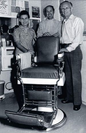 Harold ''Mick'' O'Brien, centre, with the famous barber's chair.