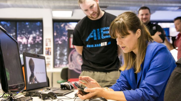 Dr Maria Stukoff checks out the new PS Vita dev kits at AIE during the PlayStation First launch.