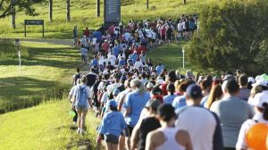 The crowd walks past the lake at the Campbelltown City Challenge Walk.