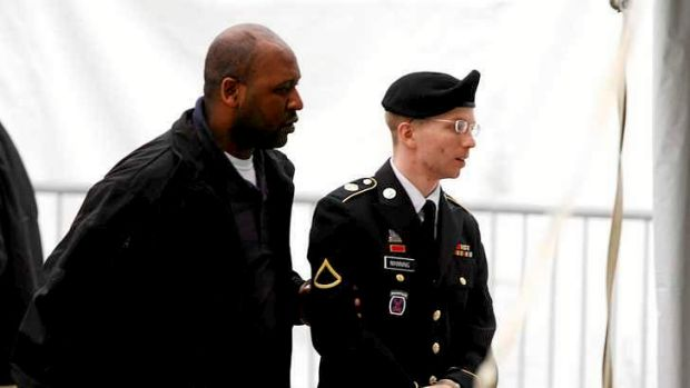 US Army Private First Class Bradley Manning arrives at the courthouse for a motion hearing at Fort Meade in Maryland. ...